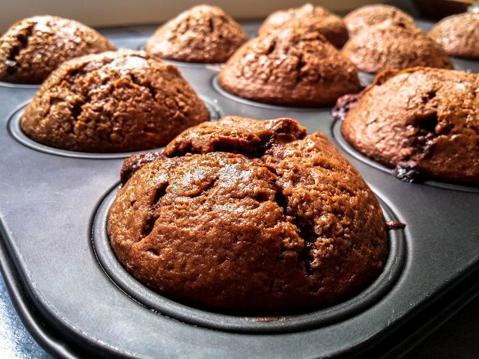 Close-up of chocolate muffins on baking tray