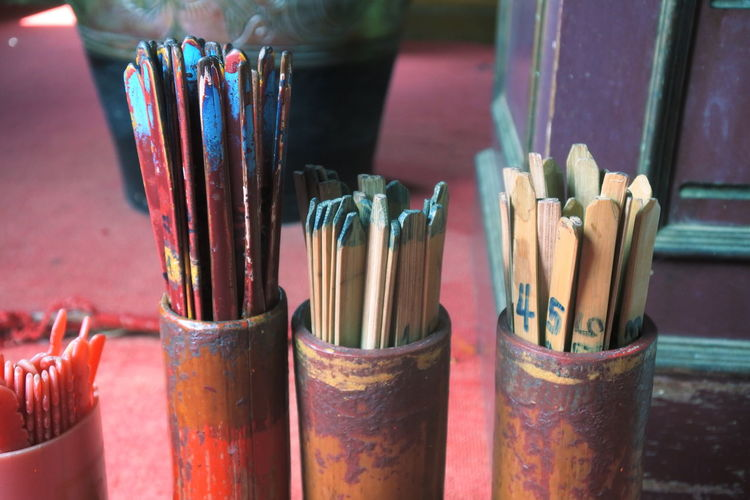 Close-Up Of Wooden Sticks In Containers