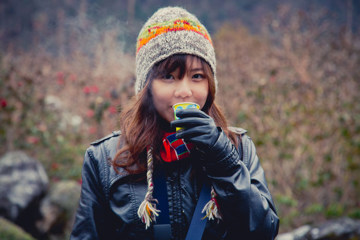 Cozy Cup Adult Always Be Cozy Asian  Autumn Beauty Casual Clothing Coffee Cozy Hat Knit Hat Knitted  Looking At Camera Modern Multi Colored Nature One Person Outdoors People Portrait Scarf Tea Warm Warm Clothing Winter Young Women