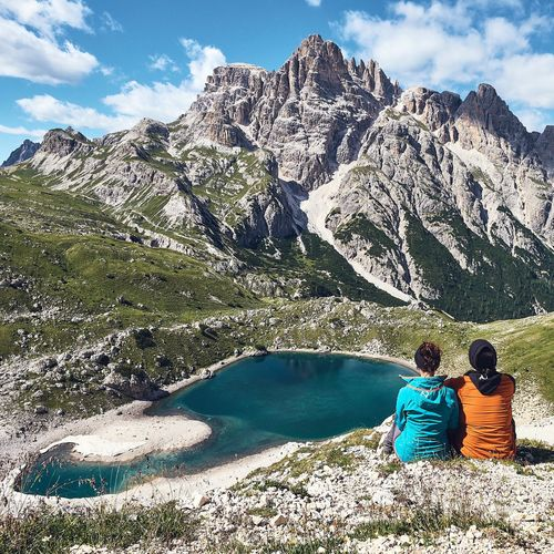 Connected By Travel Two People Mountain Day Rear View Sunlight Adult Nature Outdoors Togetherness Scenics Vacations Travel Destinations Adventure Cloud - Sky Sky People Adults Only Men Women Sitting
