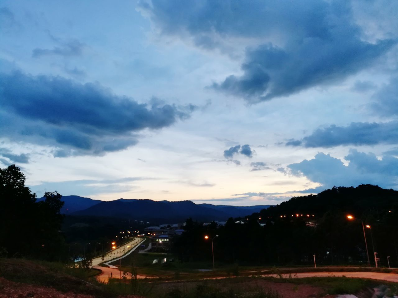 sky, cloud - sky, no people, outdoors, illuminated, scenics, beauty in nature, nature, tree, tranquility, night, mountain, architecture