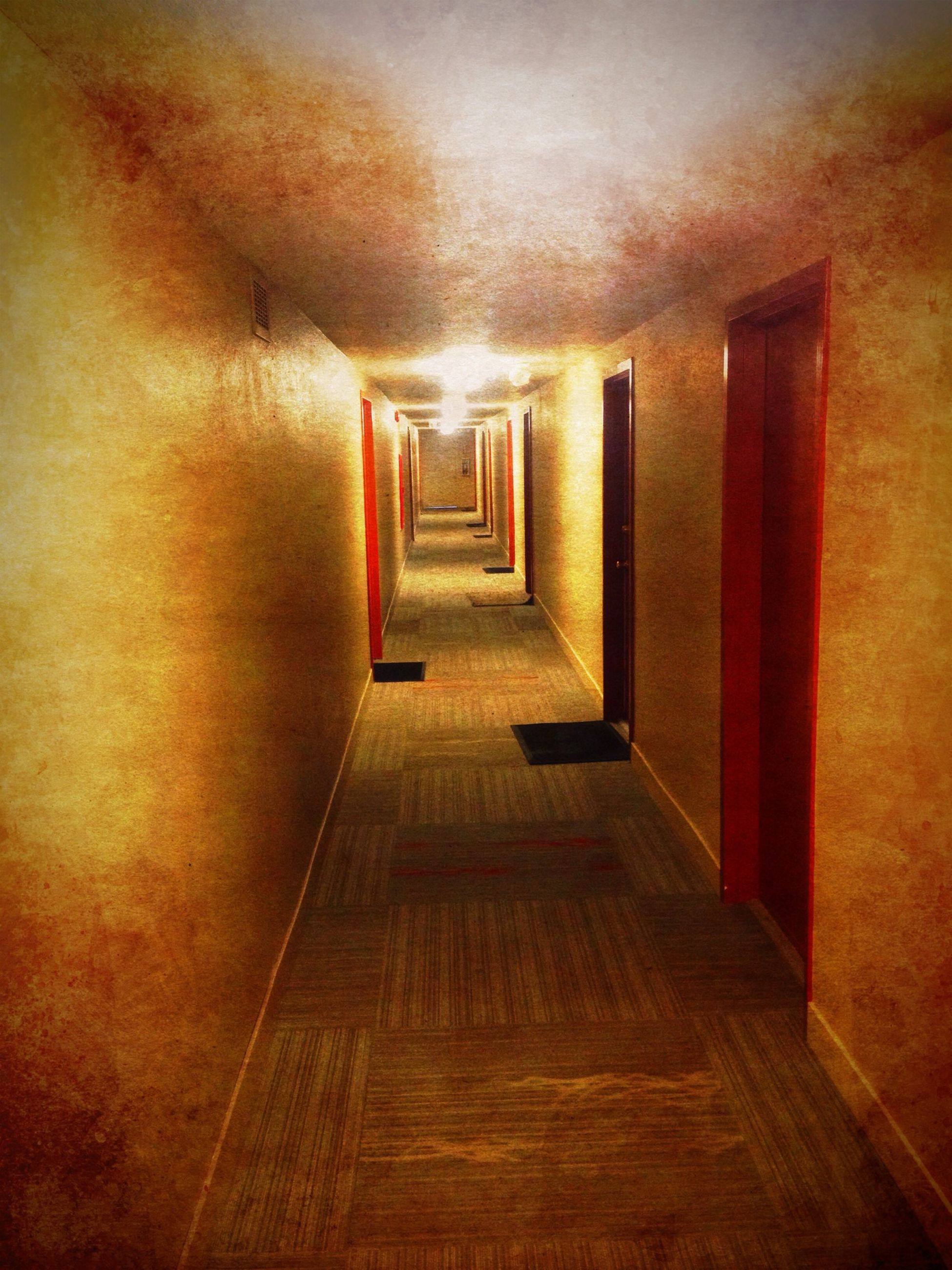 indoors, the way forward, corridor, architecture, built structure, diminishing perspective, illuminated, empty, narrow, wall - building feature, absence, flooring, ceiling, vanishing point, lighting equipment, no people, wall, walkway, long, building