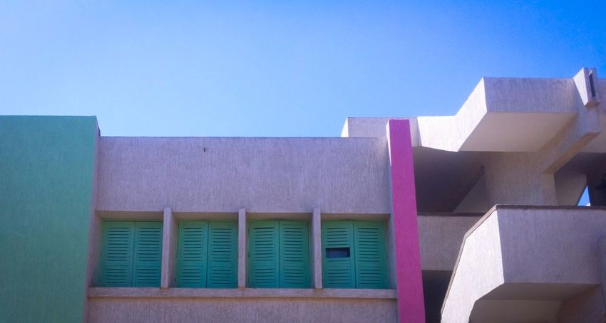 Hole in the System 🚪 📸 Architecture ArchiTexture Building Exterior School Built Structure Multi Colored Sky Blue Streetphotography Architecture Photography Architectural Detail Architectural Design Architectural Elements MnM MnMl Mnmlsm Minimalism Minimal Minimalistic Minimalmood Minimalist Window Windows