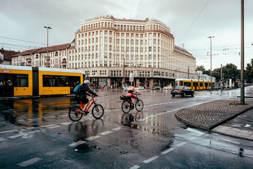 Traffic after a rain shower Soho Street Life The Street Photographer - 2018 EyeEm Awards Urban Lifestyle Urban Geometry Architecture Bicycle Building Exterior Built Structure City City Life Day Group Of People Incidental People Mode Of Transportation Outdoors Public Transportation Rain Rainy Season Real People Sky Street Streetphotography Transportation Urban