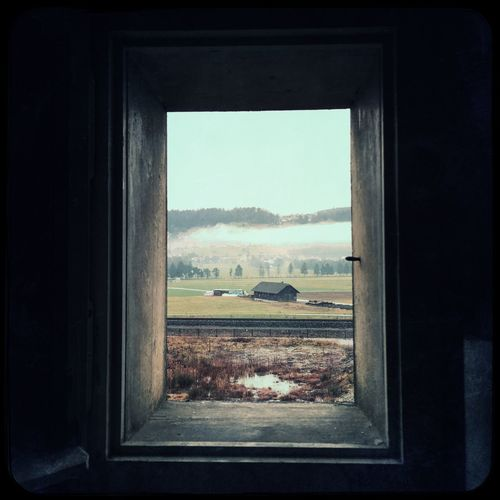 House On Landscape Seen Through Window