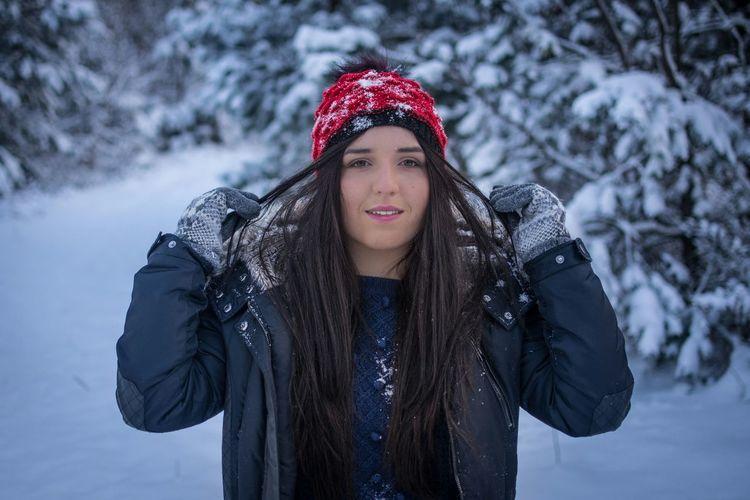 Woman wearing winter gear in snow