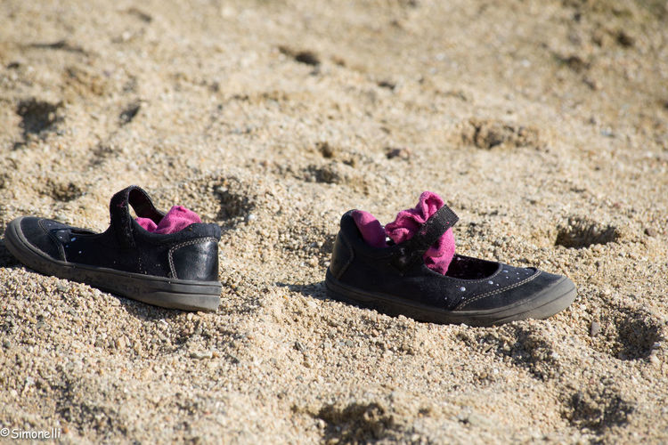 Beach Life Ground No People Outdoors Pair Sand Shoes And Socks Shoes In The Sand