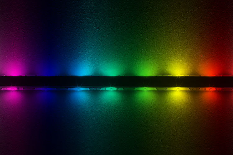 Close-up of colorful illuminated led on wall
