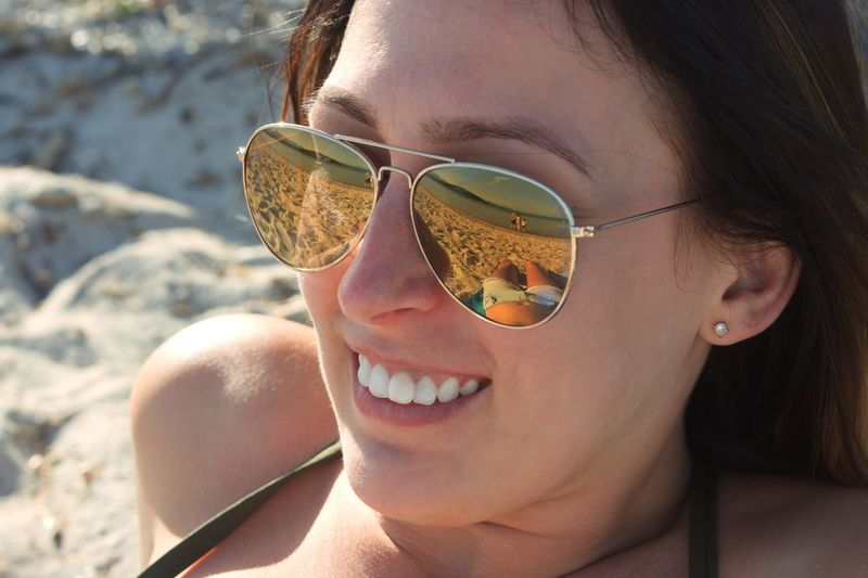 On reflection... the world is a beautiful place Reflection In Sunglasses Reflections Vacations Holidays Beach EyeEm Selects Headshot Portrait One Person Sunglasses Young Women Leisure Activity Lifestyles Close-up Young Adult Happiness Sunlight Glasses Smiling Outdoors