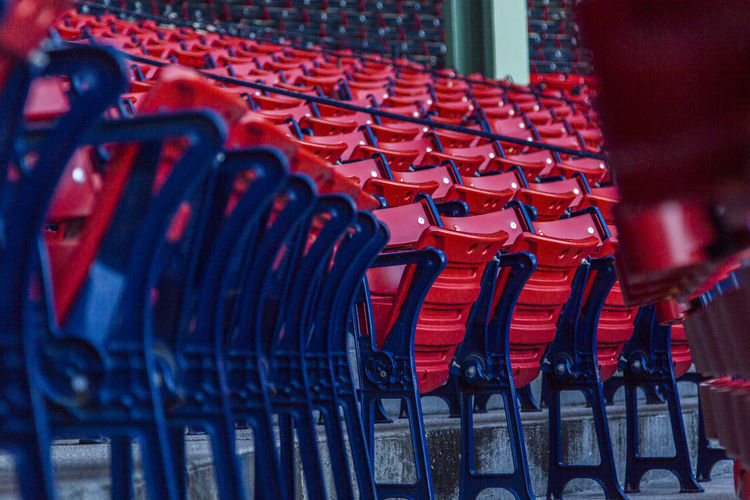Rear view of red chairs in rows