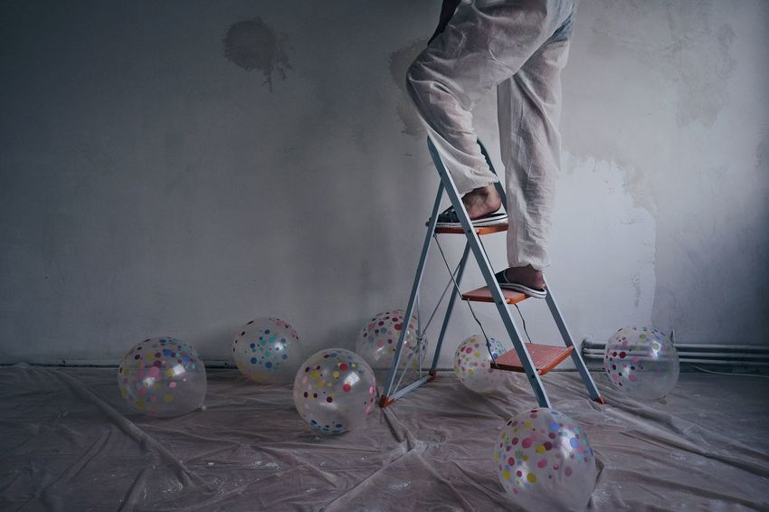 Room Renovation Renovating Balloons Interior People One Person One Man Only Men Climbing Human Body Part Home Improvement Low Section Ladder DIY Destruction Concrete Home Addition Plaster Step Ladder The Still Life Photographer - 2018 EyeEm Awards The Creative - 2018 EyeEm Awards