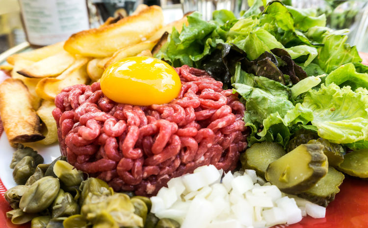 Broccoli Chopped Cilantro Close-up Food Food And Drink Freshness Green Color Healthy Eating Indoors  Indulgence Large Group Of Objects Leaf Vegetable Meal Plate Raw Beef Ready-to-eat Red Steak Tartare Tartare Temptation Variation Vegetable