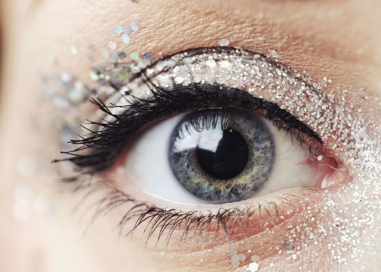 Close-up of woman with glitter eyeshadow