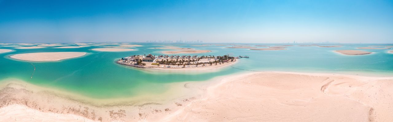 Water Sea Land Sky Beach Nature Travel Destinations Aerial View Scenics - Nature Day Travel No People Sand Tranquil Scene Beauty In Nature Blue Tranquility Outdoors Landscape Lagoon Turquoise Colored