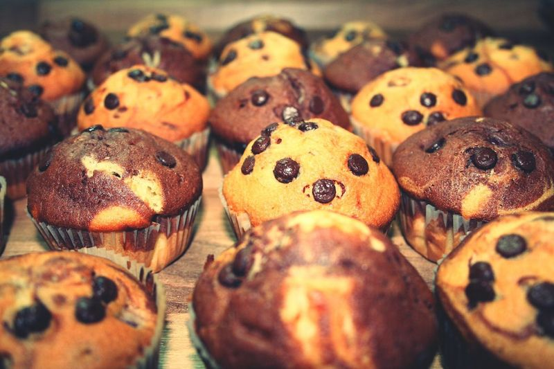 Close-up of chocolate chip muffins on table