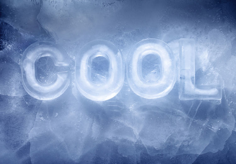 Word COOL made with real ice letters on ice.