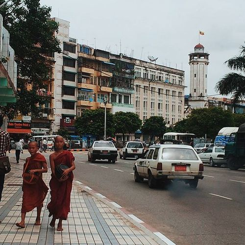 Boy monks on the streets of Rangoon in Burma near SulePagoda . Travelshots Streetphotography Cityscene Peoplewatching Travel Everydayasia Feel The Journey