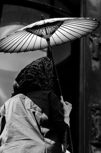 Close-up of boy holding umbrella