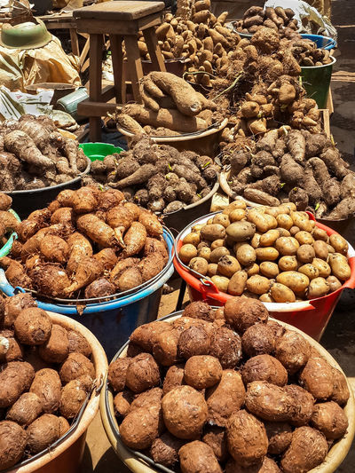 Different root vegetables and potatoes for sale from buckets on local market in Cameroon, Africa Cameroon Market Potato Abundance Africa Choice Close-up Collection Day Food Food And Drink For Sale Freshness Healthy Eating Large Group Of Objects Market Market Stall No People Outdoors Plate Potatoes Ready-to-eat Retail  Root Vegetable Variation