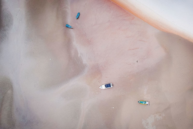 High Angle View Water Day Real People Land Nature Lifestyles Leisure Activity People Transportation Outdoors Beauty In Nature Scenics - Nature Land Vehicle Mode Of Transportation Sand Sea Unrecognizable Person