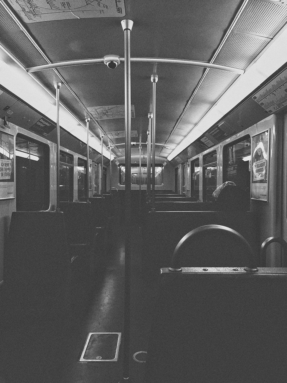 transportation, train - vehicle, vehicle interior, public transportation, rail transportation, mode of transport, train interior, indoors, vehicle seat, subway train, travel, window, journey, illuminated, no people, architectural column, commuter train, architecture, day