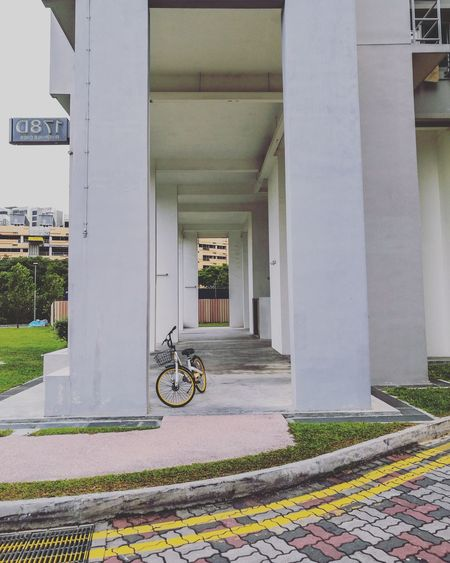 EyeEm Selects Bicycle Cycling Transportation Architecture Architectural Column Built Structure Outdoors No People Void Deck Arch Singapore Simplicity Designs Patterns Everywhere Minimal Residential Buildings Residential Neighborhood Residential Area Residential  Residential Block
