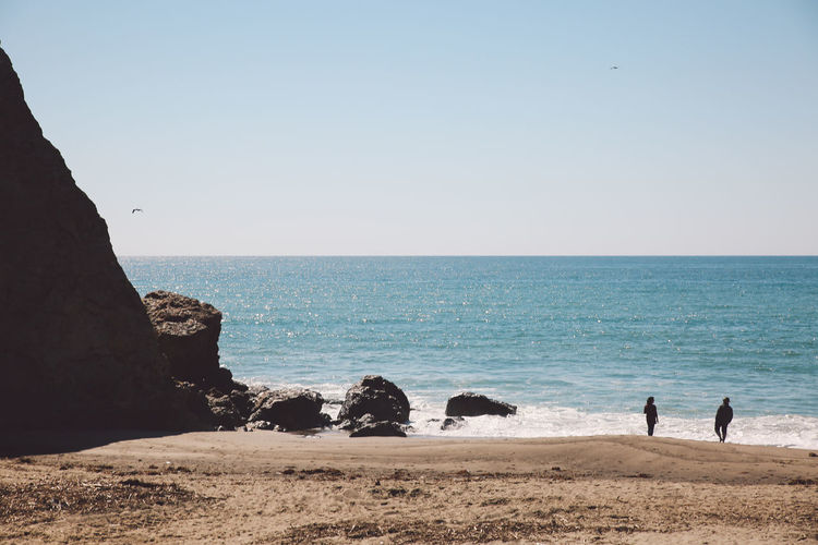 California Malibu Point Dume Tourist Attraction  Beach Beauty In Nature Clear Sky Day Full Length Horizon Over Water Men Nature Outdoors People Real People Rock - Object Sand Scenics Sea Sky Standing Togetherness Tourist Destination Tranquil Scene Tranquility Vacations Water Done That.