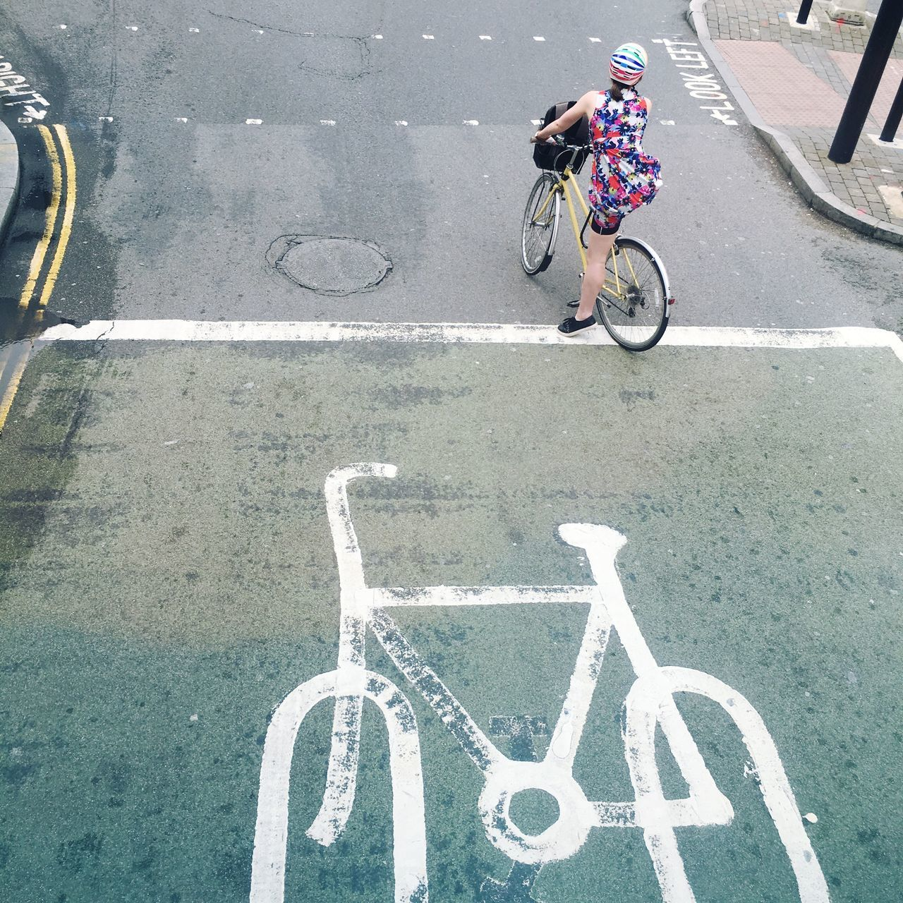 High Angle View Of Woman Riding Bicycle On Street