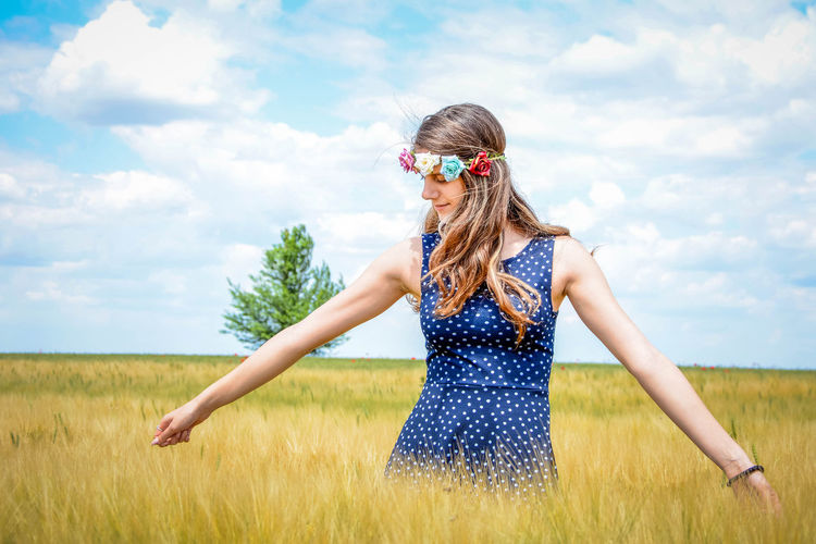 Adult Beauty In Nature Cloud - Sky Day Field Fun Grass Landscape Leisure Activity Lifestyles Nature One Person Outdoors People Real People Rural Scene Sky Standing Sunglasses Young Adult Young Women