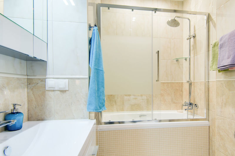 Bathroom Domestic Bathroom Hygiene Domestic Room Indoors  Towel Home Absence Hanging Sink Faucet Shower No People Household Equipment Mirror Home Interior Bathtub Tile White Color Wall - Building Feature Luxury Clean