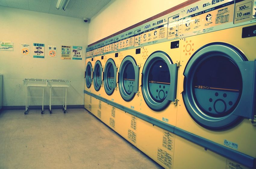 Laundromat Washing Machine Indoors  Laundry In A Row Appliance Household Equipment Side By Side Absence Machinery Text Large Group Of Objects Technology No People Repetition Architecture Dryer  Seat Wall - Building Feature Hygiene