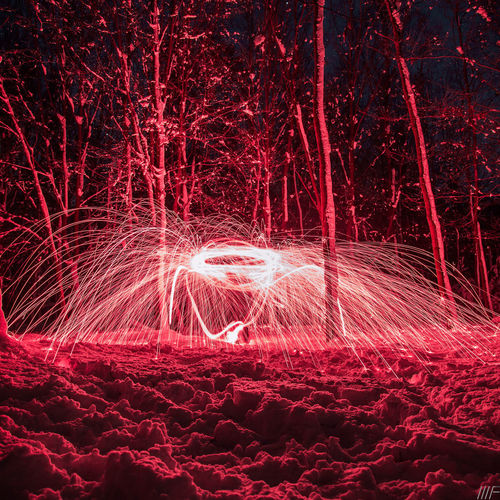 Long Exposure Night Illuminated Motion Red Light Painting Blurred Motion Glowing Creativity Wire Wool Light Trail Art And Craft No People Light - Natural Phenomenon Land Celebration Nature Pattern Sparks Arts Culture And Entertainment Outdoors Abstract Light
