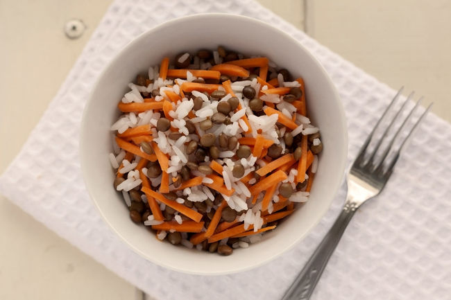 Summer Salad. Rice, lentils and grated carrots. On white napkin with fork. Diet Natural Light Rice Salad Vegetarian Food Boil Lentils Bowl Carrots Close-up Food Food And Drink Fresh Salad  Freshness Grated Grated Carrots Healthy Eating Lentils No People No People, Ready-to-eat Studio Photography Summer Salad Top View Vegan Food White Rice