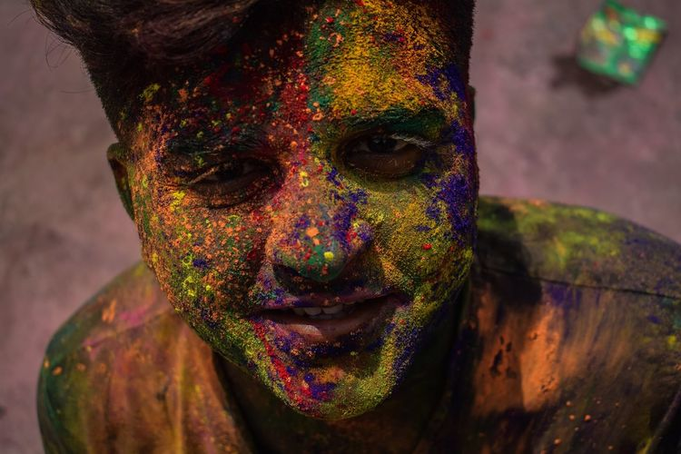 Close-up portrait of man with powder paint on face
