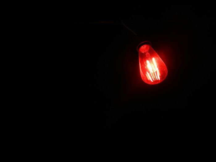 red bulb Black Background Illuminated Road Sign Technology Red Stoplight Guidance Red Light Lighting Equipment Copy Space
