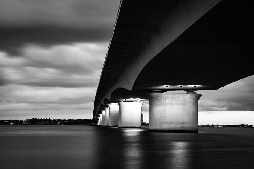 Cloud - Sky Sky Architecture Built Structure Bridge - Man Made Structure EyeEm Selects Beauty In Nature Low Angle View Dramatic Sky Seascape Photography Black And White Blackandwhite Blackandwhite Photography Blackandwhitephoto Bridge Storm Cloud Stormy Weather storm Storm Clouds Sea Sarasota Ringling Florida