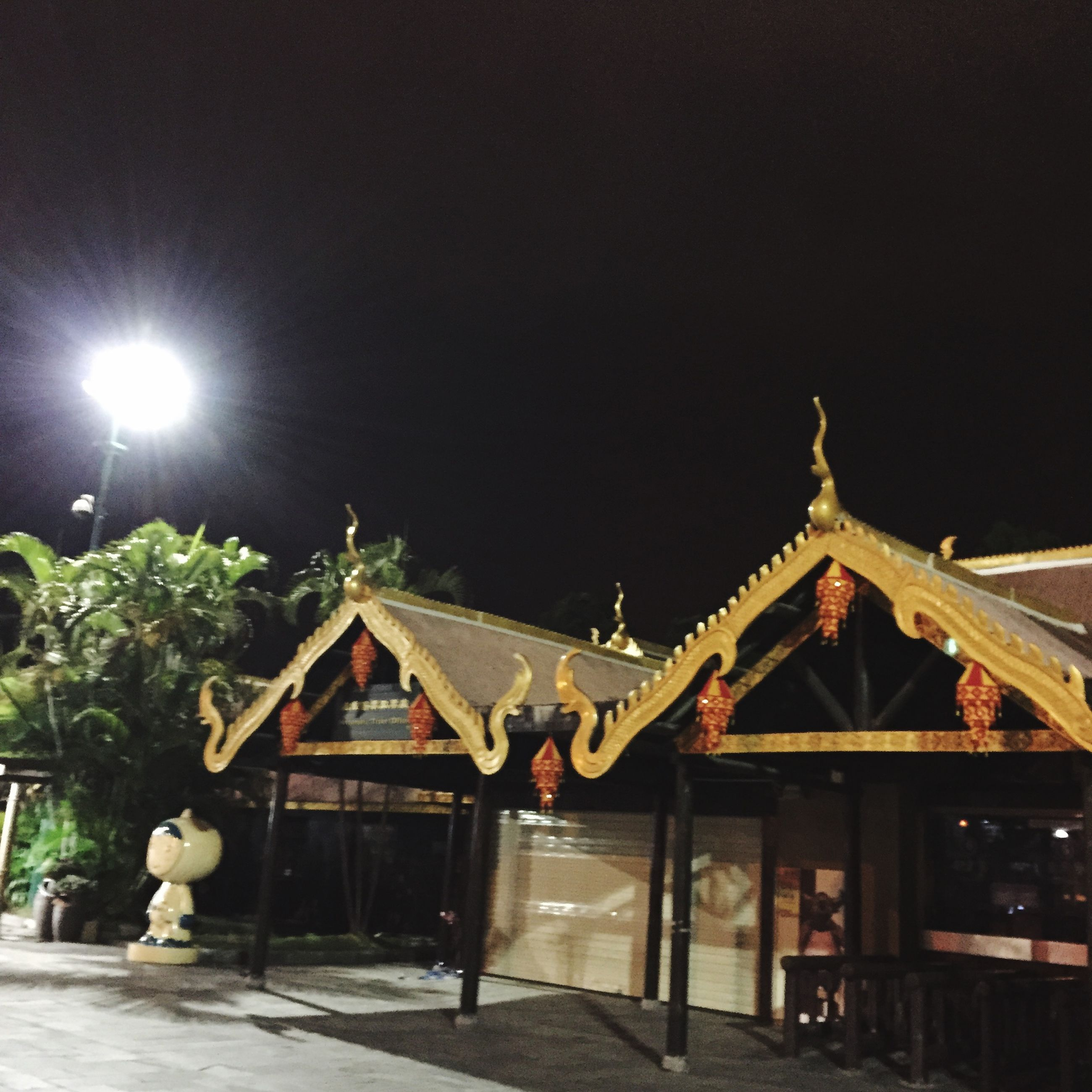 architecture, built structure, building exterior, illuminated, night, clear sky, religion, place of worship, house, low angle view, spirituality, lighting equipment, roof, tradition, outdoors, temple - building, facade, sky, no people, copy space
