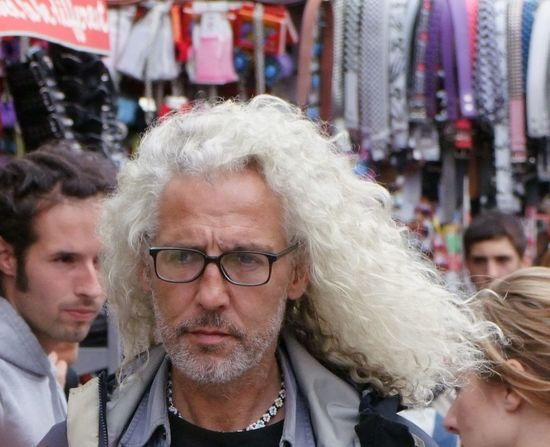 Thinking about a haircut? British Camden Market Camden Town Capital City Character Close-up Composition Eyeglasses  Frowning Full Frame GB Headshot Incidental People London Looking At Camera Man Outdoor Photography Portrait Senior Adult Senior Men Uk Unhappy Unshaven White Hair