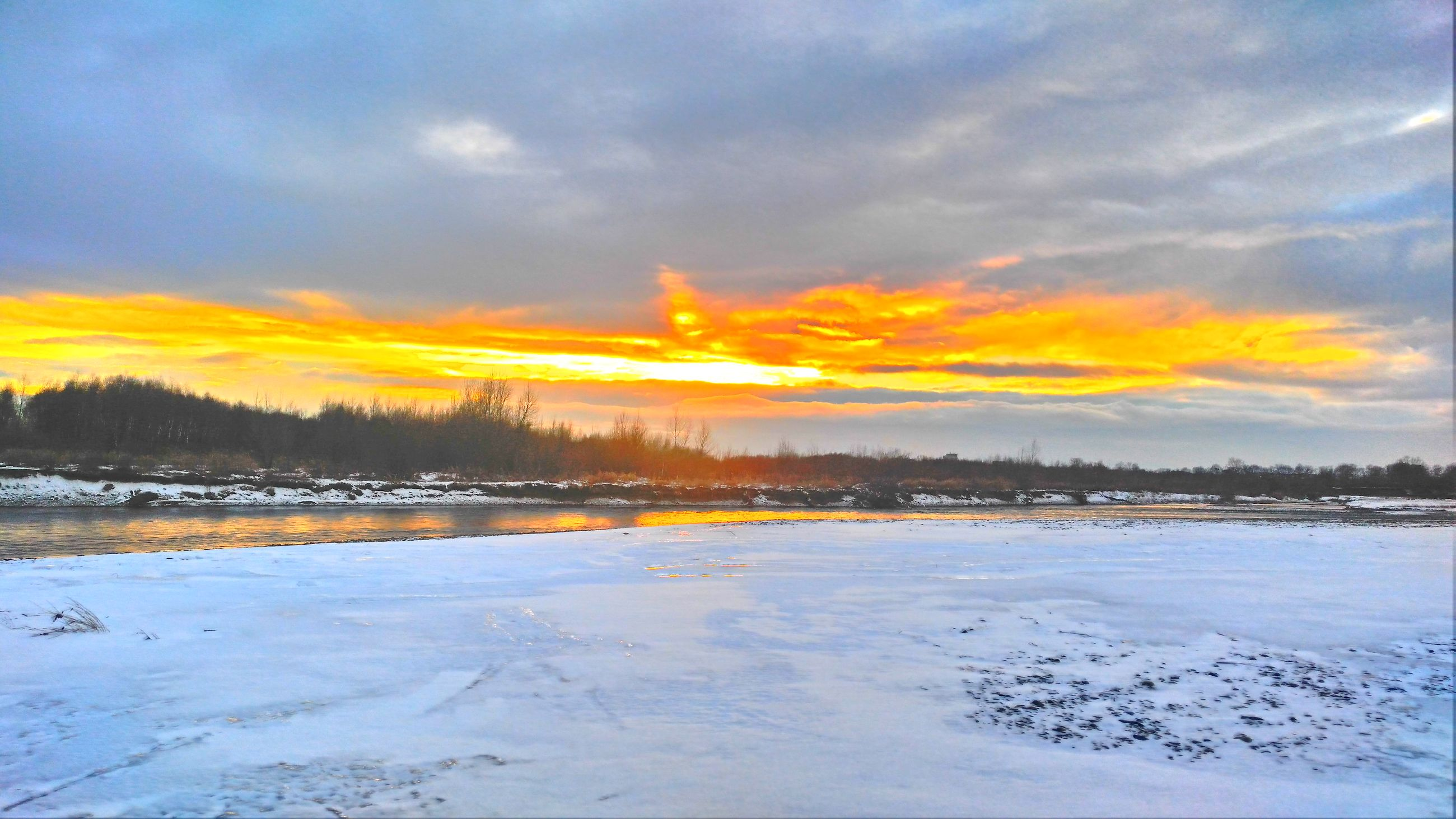 cold temperature, winter, sunset, snow, beauty in nature, nature, frozen, reflection, sky, ice, tree, cloud - sky, lake, outdoors, no people, dramatic sky, scenics, landscape, water, ice skate, ice rink, day
