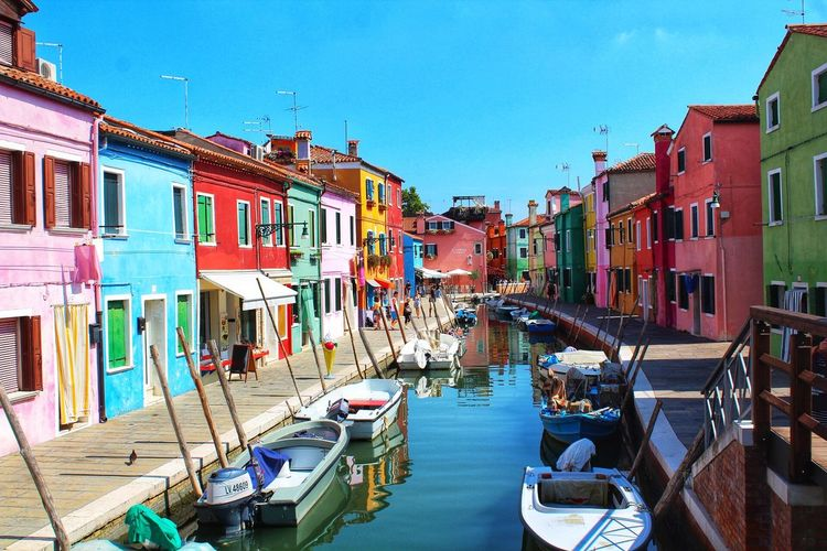 Colors in burano Building Exterior Architecture Built Structure Transportation City Mode Of Transportation Building Travel No People Town Clear Sky Canal House Moored Nature Day Residential District Nautical Vessel Water Sky