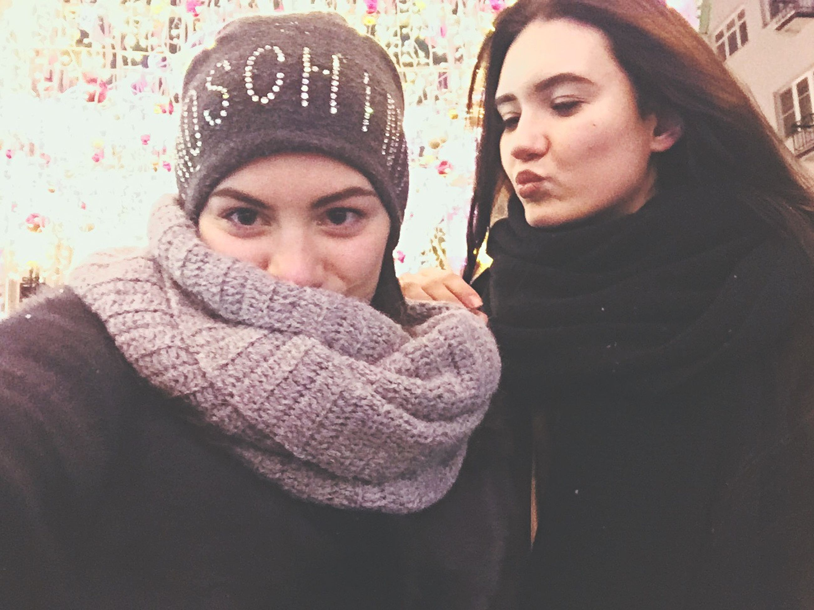 young adult, young women, two people, looking at camera, couple - relationship, warm clothing, love, women, adults only, headshot, knit hat, winter, people, hijab, adult, well-dressed, togetherness, close-up, day, beautiful woman, outdoors, place of worship