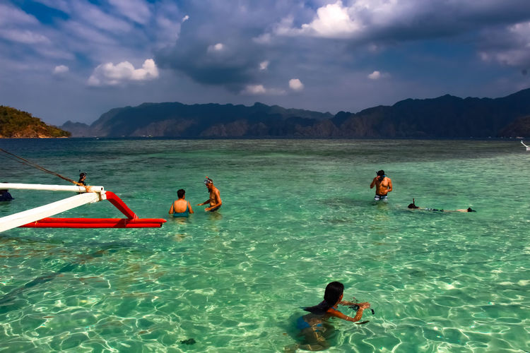 A stop over! Island hopping in Coron Palawan Philippines Beauty In Nature Boat Boating Clear Turquoise Water Cloud - Sky Enjoyment Leisure Activity Swimming Tranquility Vacations