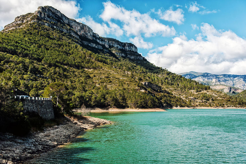 View of the Ulldecona reservoir. Valencian Community, Spain Cloud - Sky Europe Green Water Lake Landscape Mountain Nature Nobody Outdoors Reservoir Reservoir Dam River Rock Rock Formation Rocky Coast Rocky Mountains Scenery South SPAIN Sunny Day Travel Destinations Turquoise Water Ulldecona Water Waterside