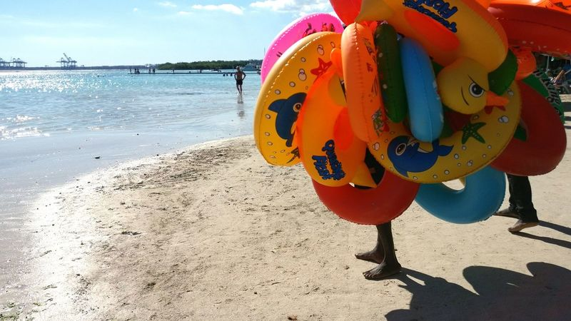 Beach Sea Sand Outdoors Nature Water No People Ball Close-up Day Sand Pail And Shovel Caribean Sea Horizon Over Water Rubber Duck Rubber Toys Rubber Rings Seller On Beach Colorful Feet Toys Toyseller Inflated Toys Inflatables The Street Photographer - 2017 EyeEm Awards