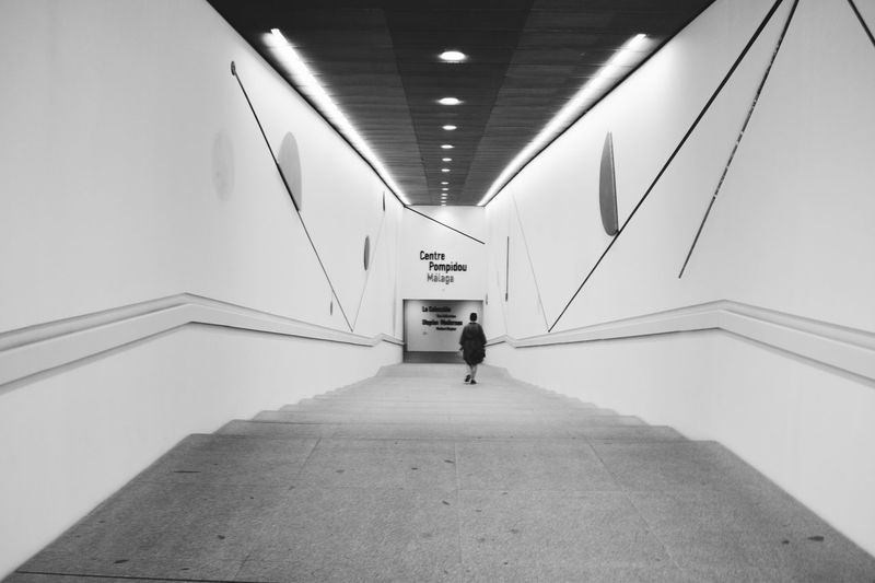 Architecture Blackandwhite Museum Staircase Architecture One Person Indoors  Ceiling Built Structure The Way Forward Real People Direction Full Length Walking Diminishing Perspective Building Lifestyles