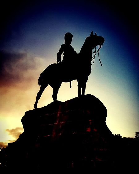 Soldier statue silhouette at sunrise Soldier Statue Edinburgh Sunrise Colurs adventures in the city Walking Around Statue Sunset Silhouette Riding Horseback Riding History Men Dusk