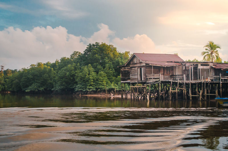 Village Village Life Village View Outdoors Sunset River The Traveler - 2019 EyeEm Awards House Traditional Traditional House Nature Nature On Your Doorstep Travel Still Life People The Great Outdoors - 2019 EyeEm Awards Tree Water Nautical Vessel Lake Stilt House Tropical Climate Reflection Beach Cultures Sky Thatched Roof