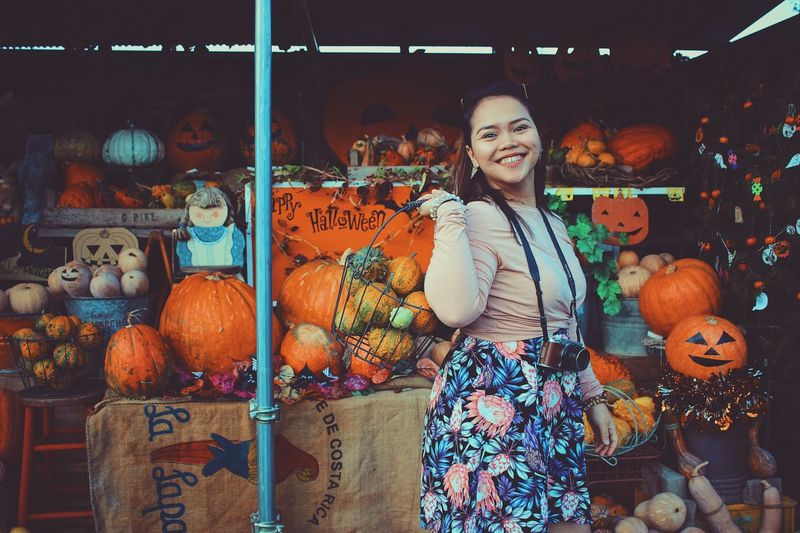 Halloween is coming to town. Photography Orange Pumpkins portrait of a friend Portrait Photography Portrait Of A Woman Portrait Halloween One Person Real People Standing Young Adult Looking At Camera Casual Clothing Food And Drink Front View Women Portrait Young Women Three Quarter Length Pumpkin Lifestyles Adult Large Group Of Objects Celebration Choice Hairstyle Autumn Mood