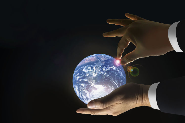 Human Hand Hand Human Body Part Holding One Person Sphere Men Indoors  Black Background Business Studio Shot Copy Space Businessman Business Person Unrecognizable Person Males  Globe - Man Made Object Body Part Suit Finger Human Limb Global Control