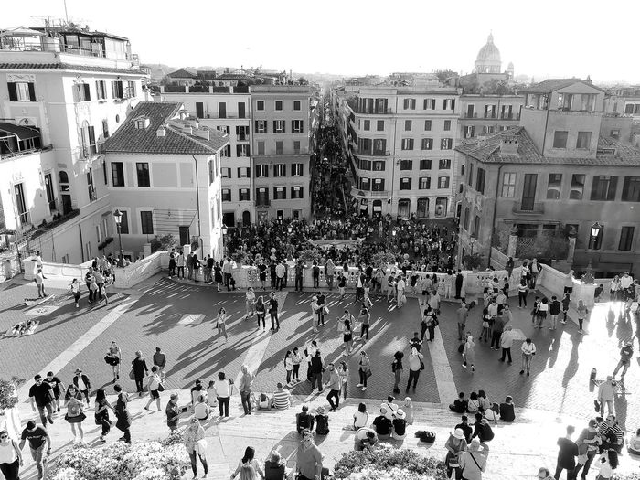 High angle view of people on street against buildings in city